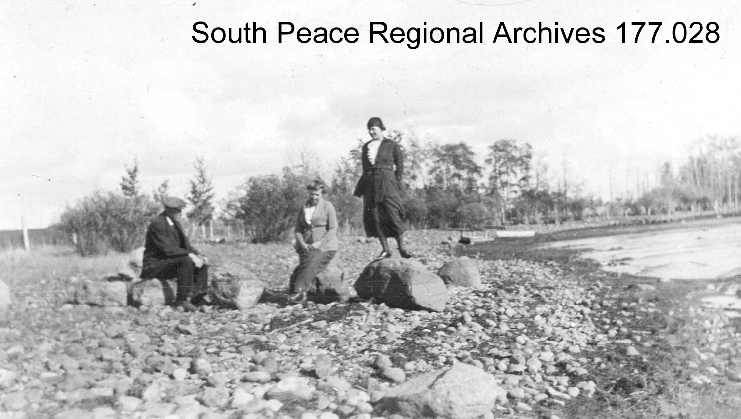 SPRA 0177.028: Mr & Mrs. Bredin with Marjory Bradford, daughter of Dr. Andrew Bradford, on the shores of Bear Lake near their home, ca. 1920.