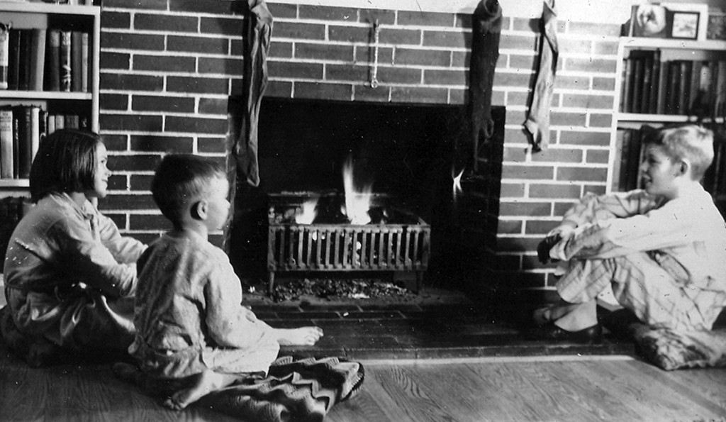 Mary Jean, David,and Jim Carlisle in front of the fireplace at Christmas, 1939