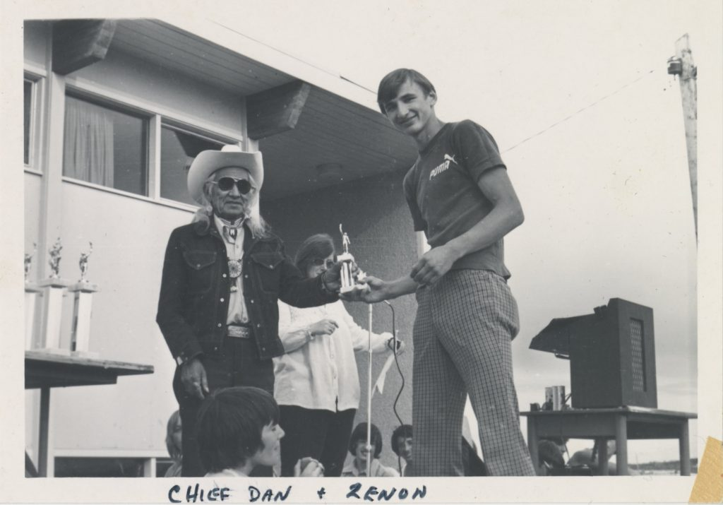 Image shows Chief Dan George presenting Zenon Smiechowski with an Outstanding Athlete award. Photo is taken at the Fort St. John Invitational Track Meet in June 1973.