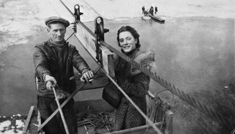 a man and a woman aboard an aerial ferry. The photo is taken from a high angle, like a modern selfie