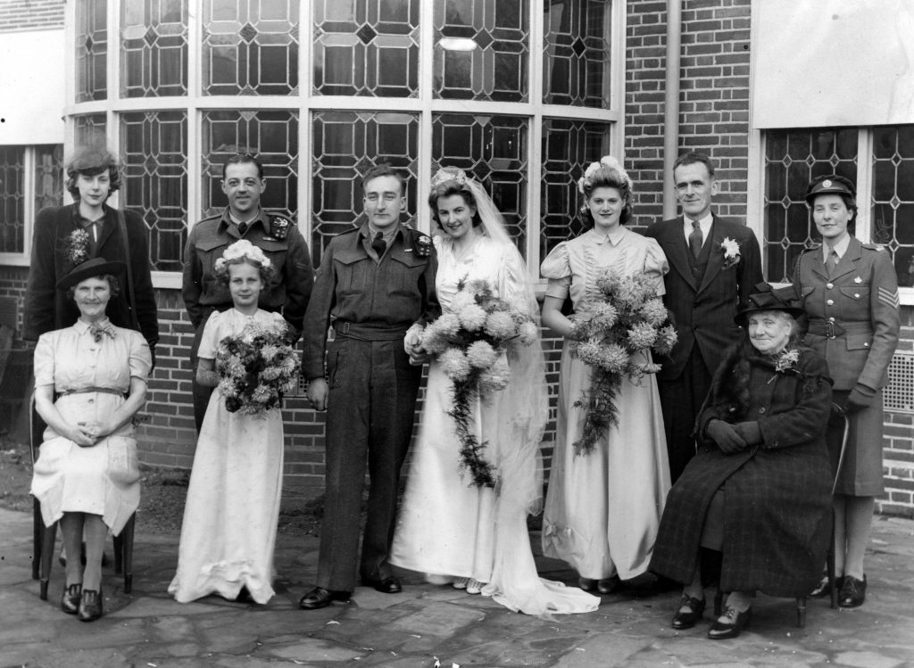 Hilary and Jim Lightfoot photographed with their wedding party in December of 1944.