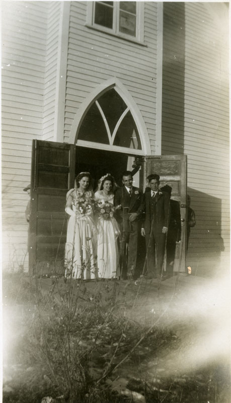Wedding photo for Barbara Klukas and Mathew Wozniak on the steps of the Eaglesham Catholic Church. From left to right, Cecilia Wozniak, Barbara, Mathew, Campbell Klukas.
